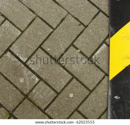 caution sign on stone tile road - stock photo
