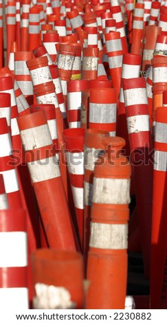 caution traffic signs, orange safety cones and amber warning lights