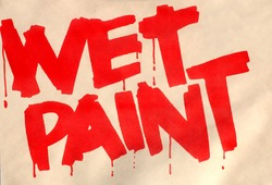 Caution warning sign of wet paint notice