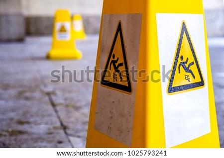 caution wet floor sign at a sidewalk #1025793241