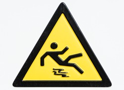 caution wet floor sign - warning sign at an entrance of a university in rome - not a vector
