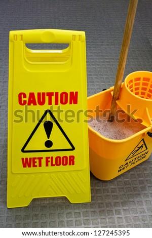 Caution wet floor sign with mop and bucket Stock foto ©