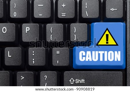 caution words on blue and black keyboard button