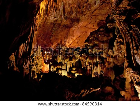 Cave interior with stalagmites and exotic colors
