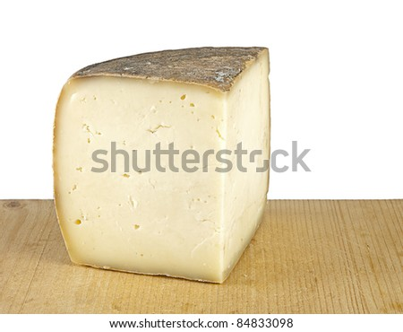 Cave matured with ash, pecorino sheep cheese on wooden block, white background