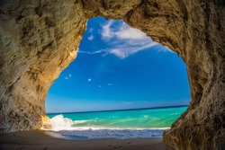 Cave on the beach of Cala Luna from inside to the mediterranean sea
