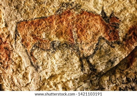 Cave picture of brown bison painted on the rock