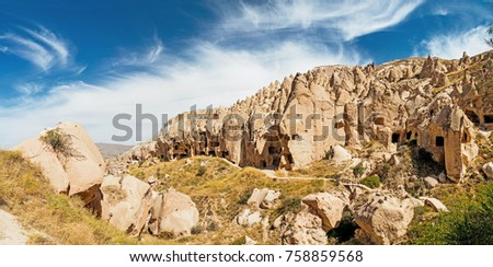 Cave town and rock formations in Zelve Valley, Cappadocia, Turkey #758859568