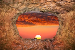 Cave view of sunset sky. Magic world of the underground caves