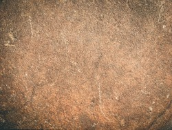Cave wall rustic rough stone Brown grungy rock surface for texture and background design backdrop.