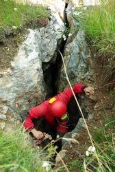 Caver descends in a cave. Spelunking is an extreme sport