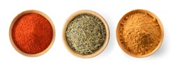 Cayenne pepper, Dried rosemary leaves, Cinnamon Powder in wood bowl on white background