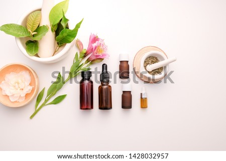 Photo of  cbd and herb oil for therapy  or treatment as alternative medicine .essential  fragrance aromatherapy . natural organic herbal product for health and wellness.