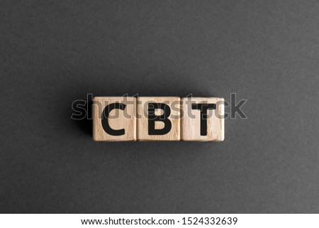 CBT - acronym from wooden blocks with letters, abbreviation CBT Cognitive behavioral therapy concept, gray background
