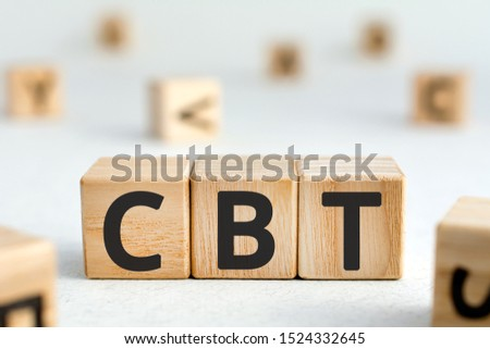 CBT - acronym from wooden blocks with letters, abbreviation CBT Cognitive behavioral therapy concept, random letters around, white  background