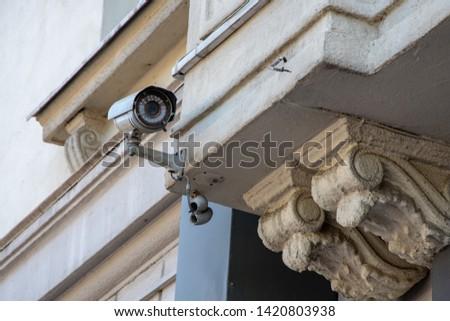 CCTV camera attached on the wall of the building, monitoring and tracking, monitoring the situation #1420803938