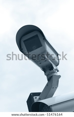 CCTV camera mounted outdoors - stock photo