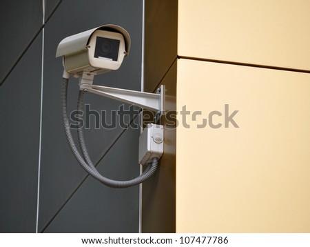 CCTV camera on a wall watch rigth
