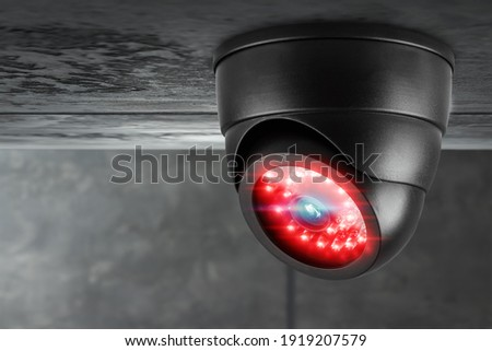 CCTV camera under the ceiling. Cameras work day and night, video recording in the dark. Protection from thieves and vandals Photo stock ©