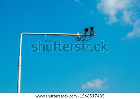 CCTV cameras installed on roads to control the traffic and security. In public, to the public.