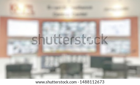 CCTV Monitor room blur background with blurry multiple video camera monitoring security guard network system for business, shop or office building safety  #1488112673