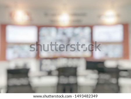 CCTV Monitor room blur background with blurry multiple video camera monitoring security guard network system for business, shop or office building safety  #1493482349