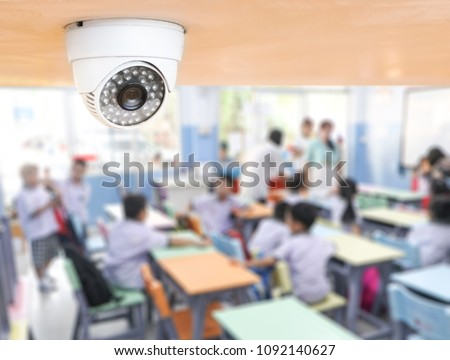 CCTV Security monitoring student in classroom at school.Security camera surveillance for watching and protect group of children while studying. #1092140627