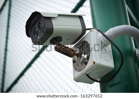 CCTV security on the  iron fence.