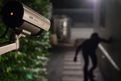 CCTV surveillance camera operate during night capture thief while break into a house