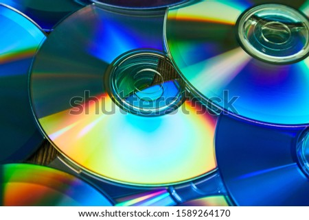 CD copmact discs in a pile making a shiny background