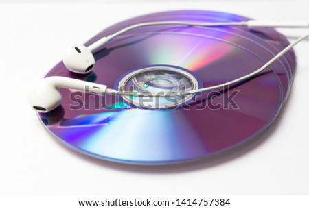 cd , dvd disks with headphones isolated