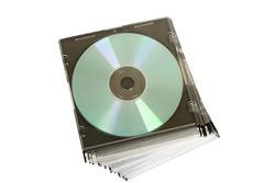 cd dvd piled up on white background