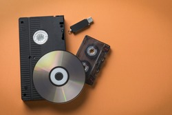 CD-ROM and video-audio cassette flash drive as a concept of media storage evolution.