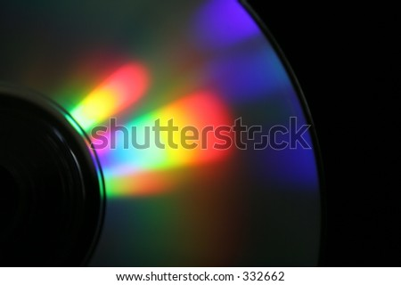CD, somewhere between reflexion and refraction. Black background - stock photo