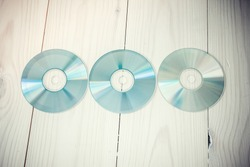 cds and dvds on wooden background