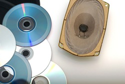 CDs and vinyl records next to the speaker speaker on a white background sound recording technology concept. High quality photo
