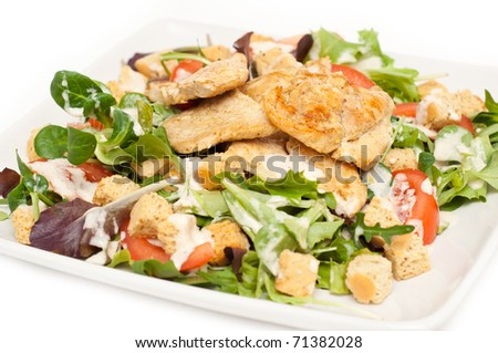 Ceasar salad on a plate isolated on white