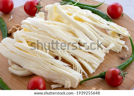 Cecil cheese on wooden background. Angel Hair Cheese, or stringy cheese. Stok fotoğraf ©
