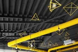 Ceil of interior industrial cement loft design concept modern.Yellow ventilation pipe and geometrical figures. contrast.Grey and yellow.Creative.