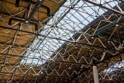 Ceiling at airport - modern architecture. Metal roof frame with lighting and ventilation systems of modern mall building