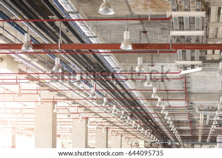 Ceiling cement structure with pipe network and electric of building warehouse Stock fotó ©