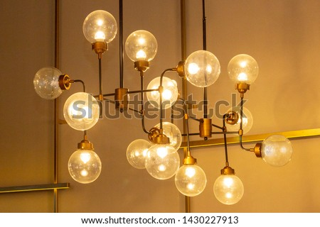 ceiling chandelier from a variety of lamps. modern design, loft, unusual lamp