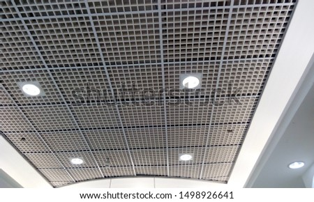 Ceiling finishes of macro Grid ceiling is covered Gypsum false ceiling for an Big retail shop commercial building interiors finishes