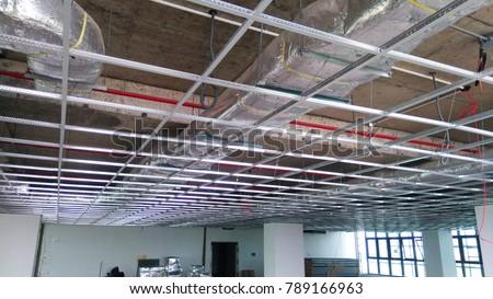 Ceiling grid work for luxury building.Above soffit level services. Foto d'archivio ©