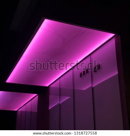 Ceiling lit up by neon lights