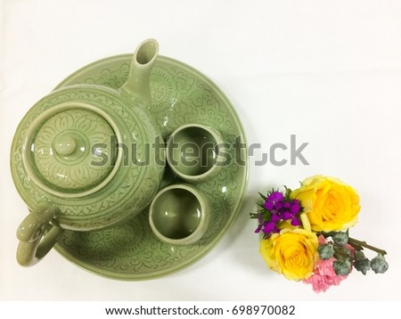 Celadon tea pot and celadon tea cup with small flower vase on white background #698970082
