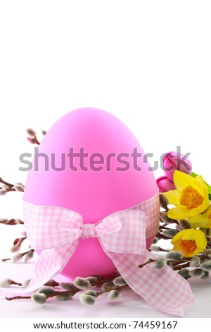 Celebrate Easter with this large pink egg decorated with spring flowers and a checkered bow - ample copy space  is available