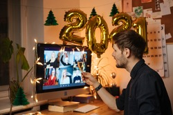 Celebrate New Year's Eve At Home This Year. Host a video call with loved ones. Virtual toast with your friends. Entertainment at remote call and decorate foiled balloons of 2021.