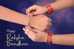 celebrated in India as a festival denoting brother-sister love and relationship. A sister is binding rakhi on her brother hand on the festival of raksha Bandhan