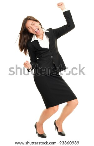 Celebrating business woman dancing happy joyful cheering in suit isolated on white background in full body. Ecstatic and excited beautiful multiracial Caucasian / Chinese Asian young business woman